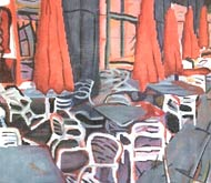 Sidewalk umbrellas and chairs