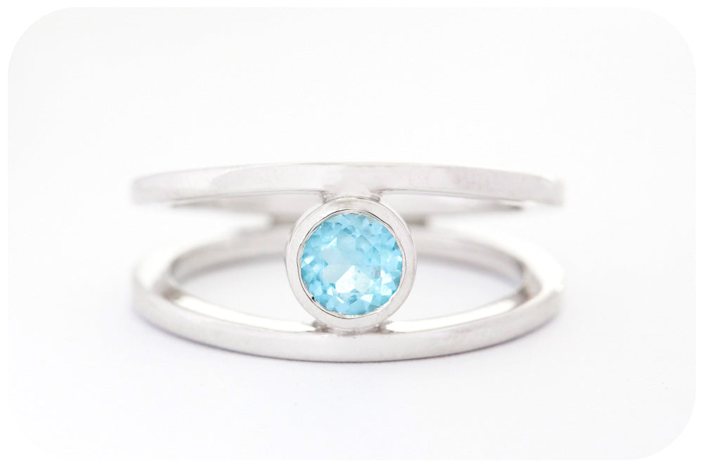 Round cut Swiss Blue Topaz Ring with a Split Band Design in Sterling Silver