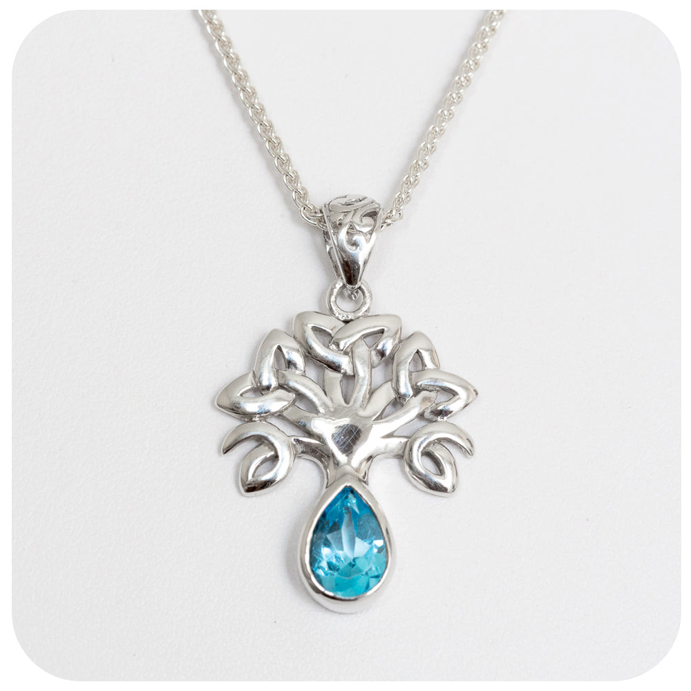 Radiant Tree of Life Pendant Swiss Blue Topaz crafted in 925 Sterling Silver - Victoria's Jewellery