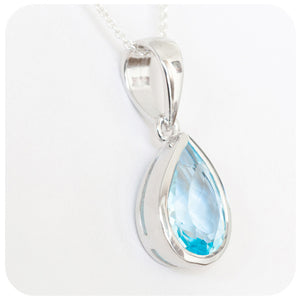 Radiant 14mm Blue Topaz Pear Cut Pendant solidly set in 925 Sterling Silver - Victoria's Jewellery