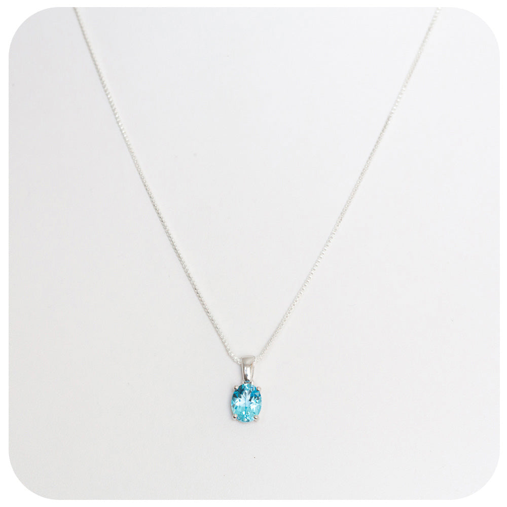 Oval Cut Radiant Blue Topaz Pendant set in Sterling Silver - Victoria's Jewellery