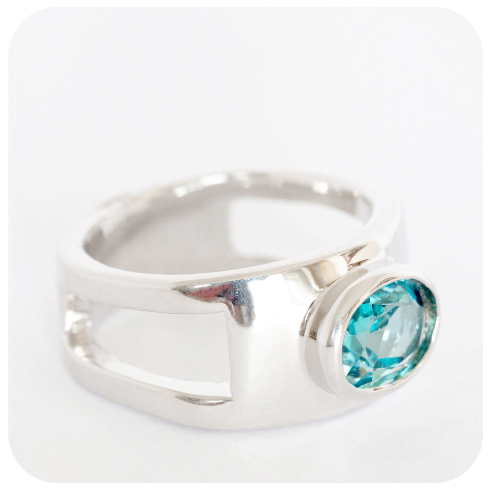 Oval cut Blue Topaz Ring crafted in solid 925 Sterling Silver with Cut-Out Side Detailing - Victoria's Jewellery