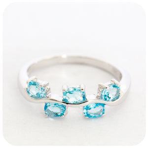 Striking Swiss Blue Topaz Multi-stone Ring Set in 925 Sterling Silver with a fine Rhodium finish - Victoria's Jewellery
