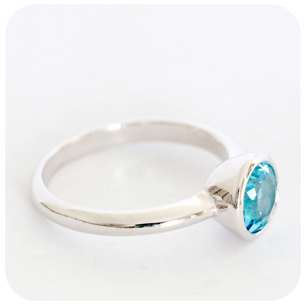 Swiss Blue Topaz Ring Tube Set in a solid 925 Sterling Silver - Victoria's Jewellery