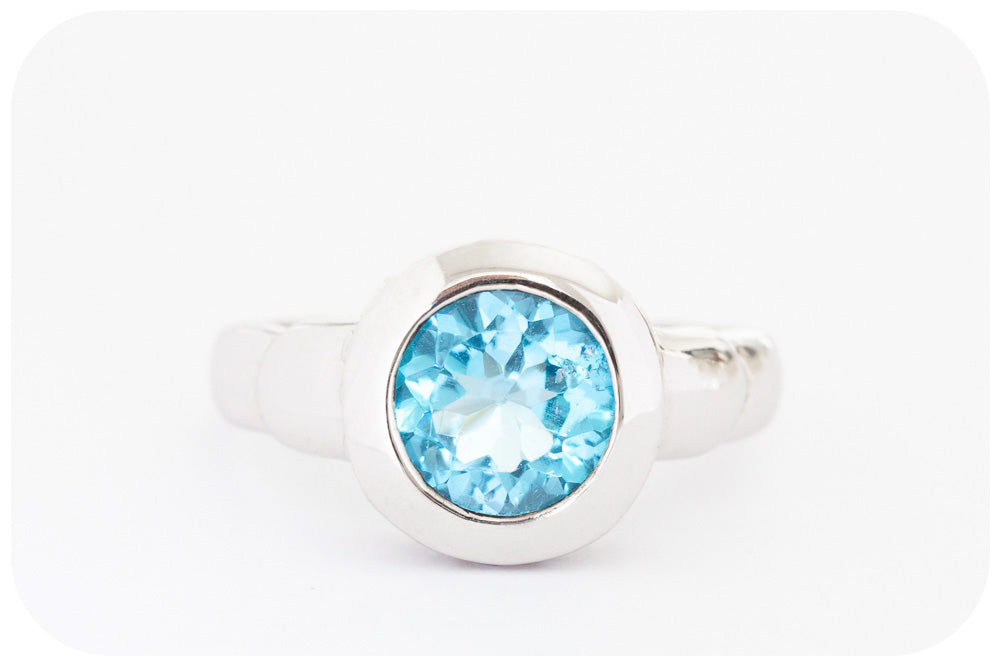 Round cut Blue Topaz Ring in Sterling Silver with a Fine Rhodium Finish - Victoria's Jewellery