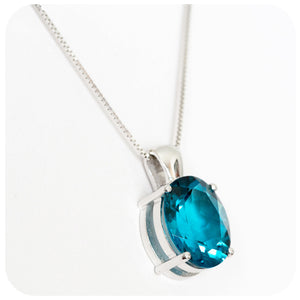 18k White Gold Pendant with a Decadently Deep London Blue Topaz - Victoria's Jewellery