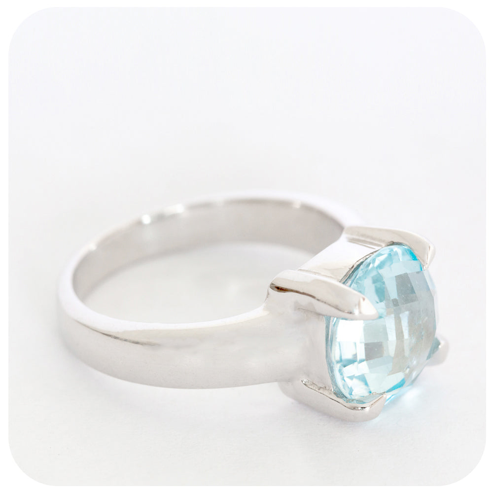 A Round Sky Blue Topaz Ring with a detailed Checkerboard Cut Crafted with 925 Sterling Silver - Victoria's Jewellery