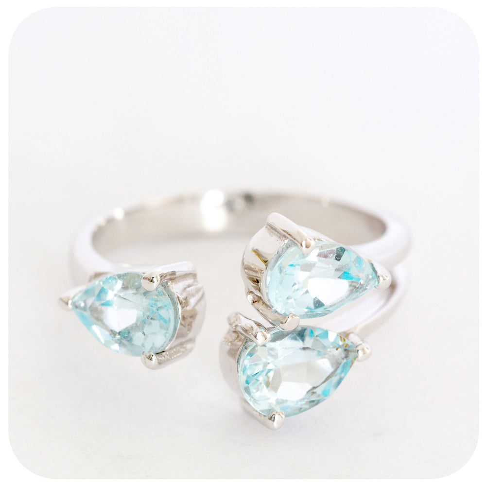 A Sky Blue Topaz 3 Stone Pear Cut Ring Delicately Crafted in 925 Sterling Silver - Victoria's Jewellery