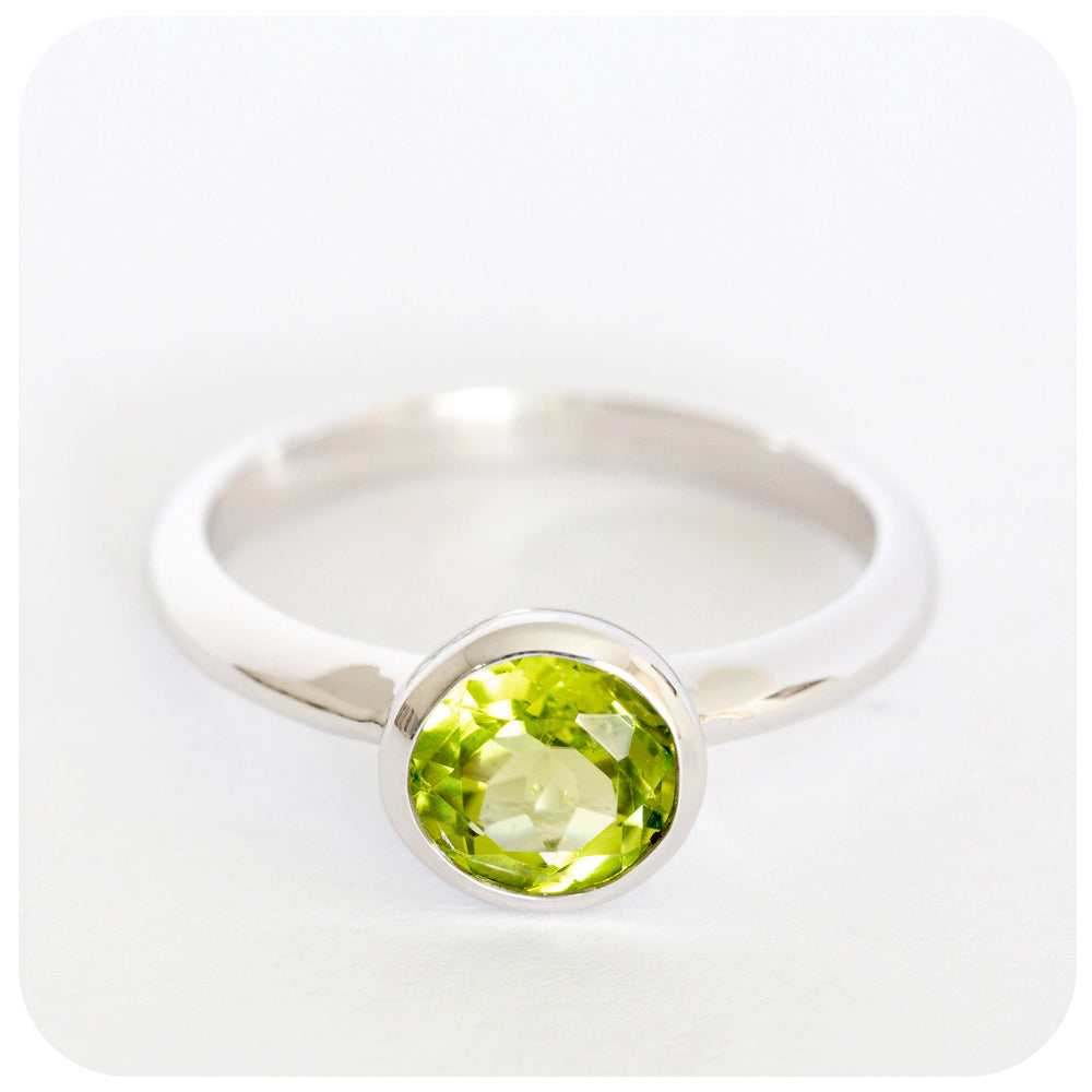 The lovely little Peridot Ring manufactured locally in 925 Sterling Silver - Victoria's Jewellery