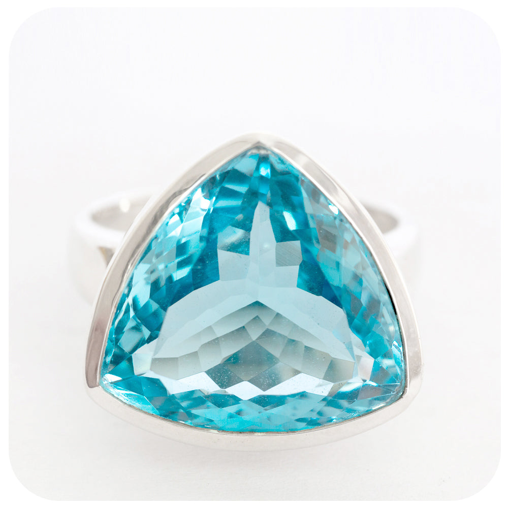 Majestic Large Trillion Cut Blue Topaz Ring Crafted in 925 Sterling Silver - Victoria's Jewellery