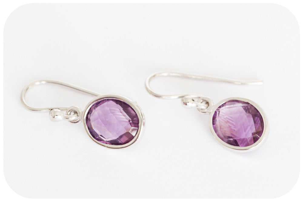 Oval cut Amethyst Earrings in Sterling Silver with a Rhodium Finish