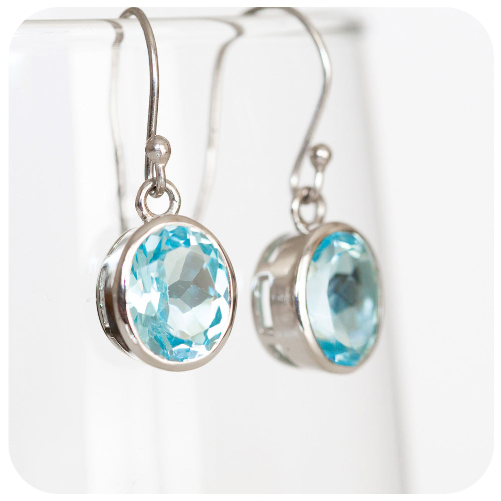 Oval cut Sky Blue Topaz Dangling Earrings crafted in 925 Sterling Silver - Victoria's Jewellery