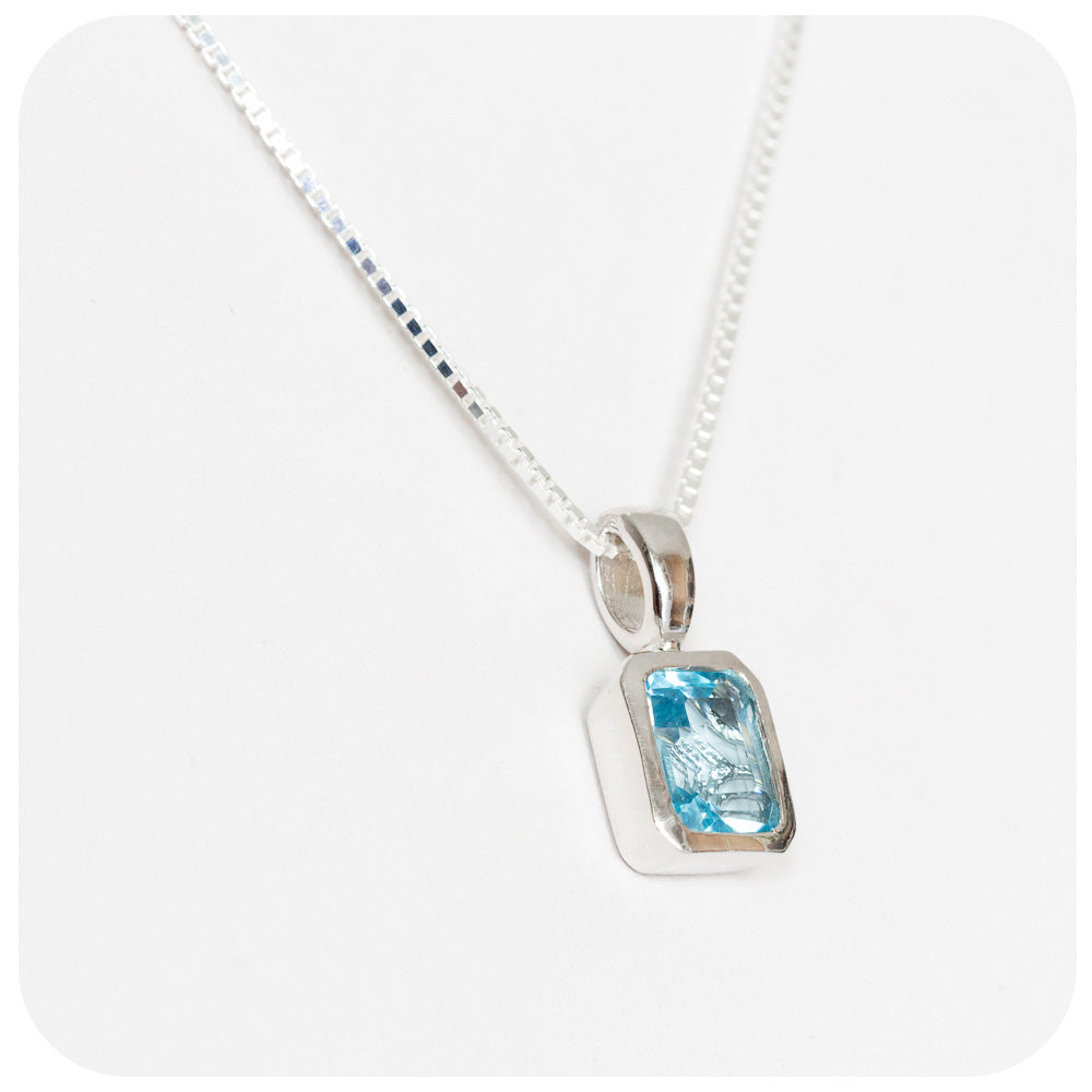 Emerald cut Blue Topaz Pendant in Sterling Silver - 10x8mm