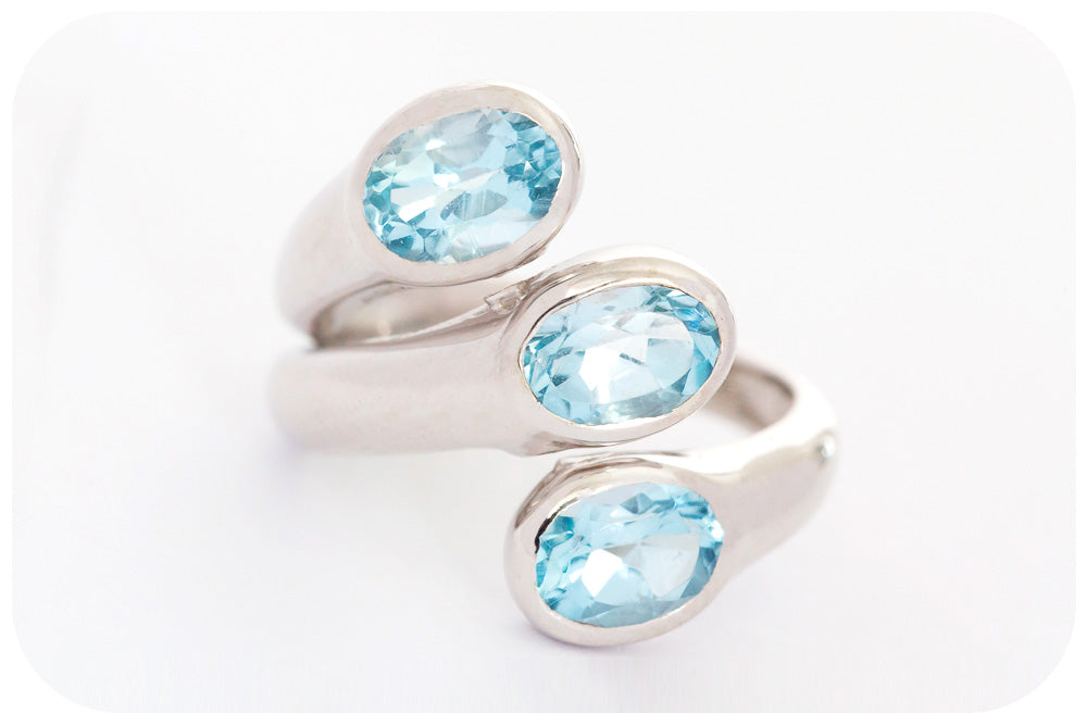 Trilogy Sky Blue Topaz Ring in Sterling Silver