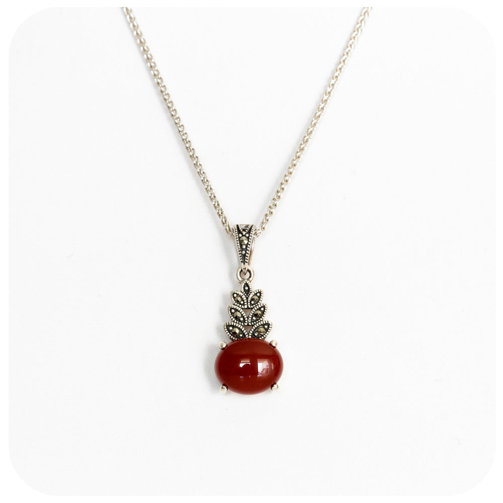 Oval Cabochon cut Carnelian and Marcasite Pendant in Sterling Silver