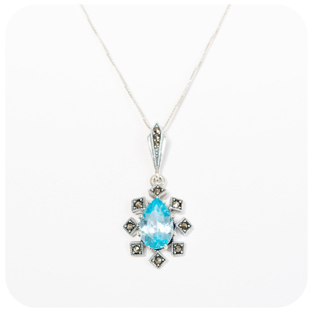 Pear cut Swiss Blue Topaz and Marcasite Pendant in Sterling Silver