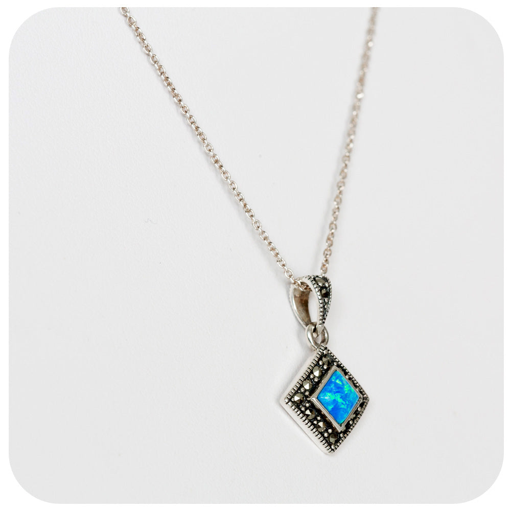 Blue Gilson Opal and Marcasite Pendant in Sterling Silver
