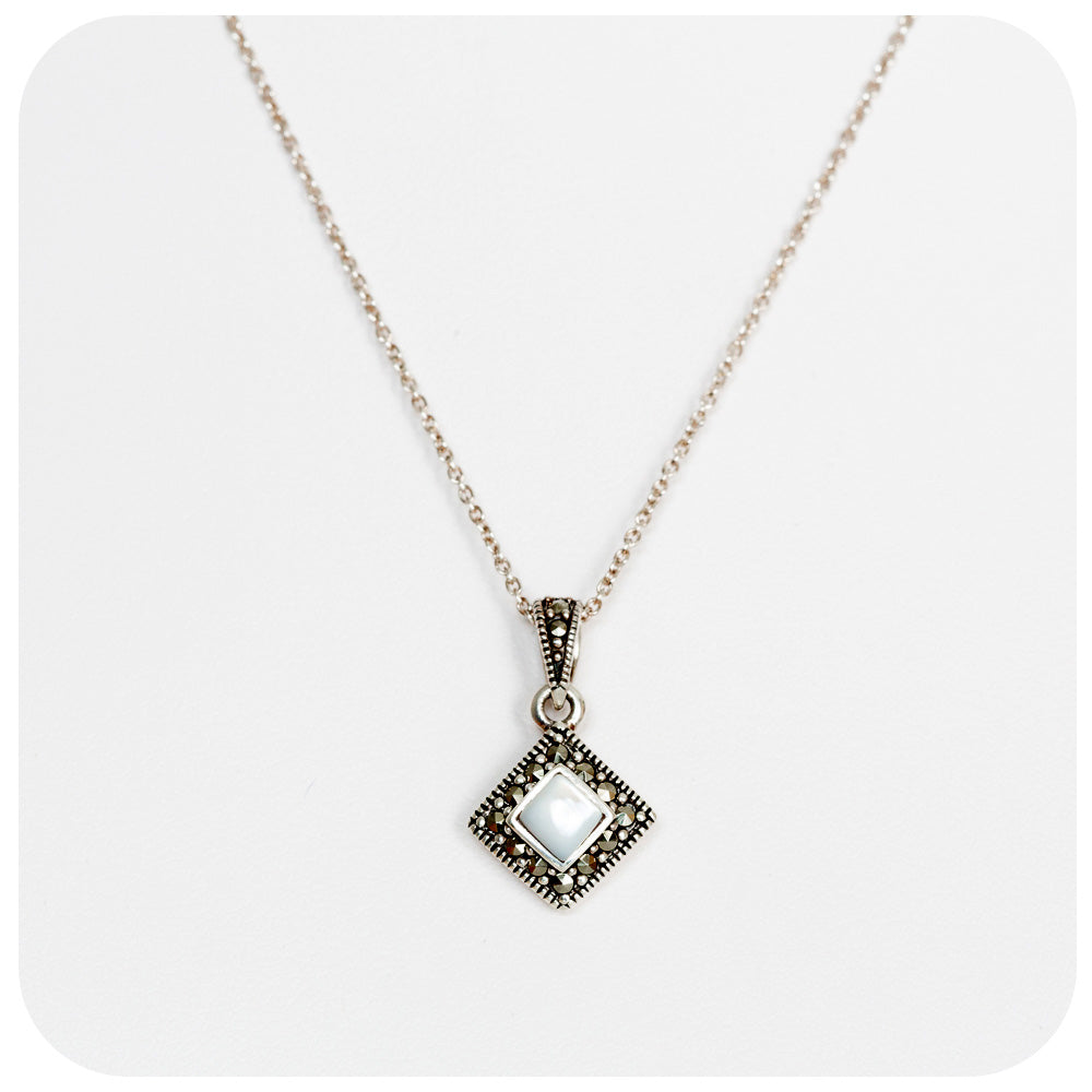 Lustrous White Mother of Pearl and Marcasite Pendant in Sterling Silver
