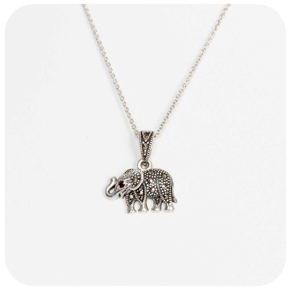 Beautifully detailed Elephant Pendant in Sterling Silver with Marcasite and Garnet Stones