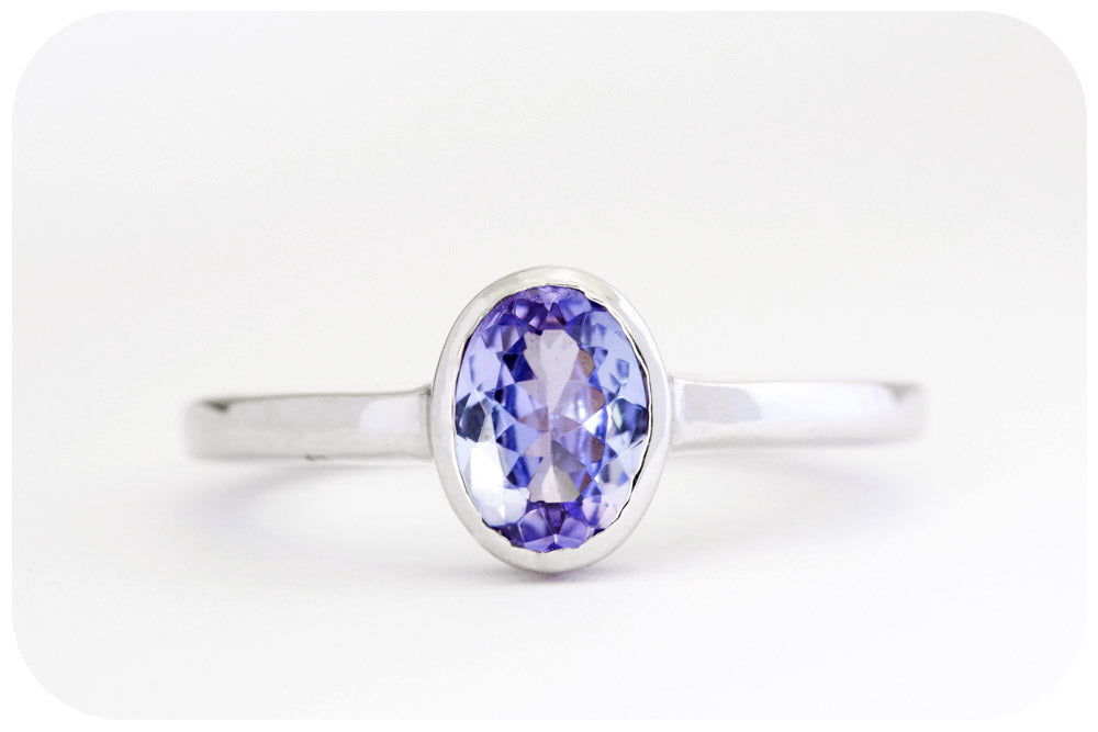 Oval cut Tanzanite Solitaire Ring in Sterling Silver - 7x5mm