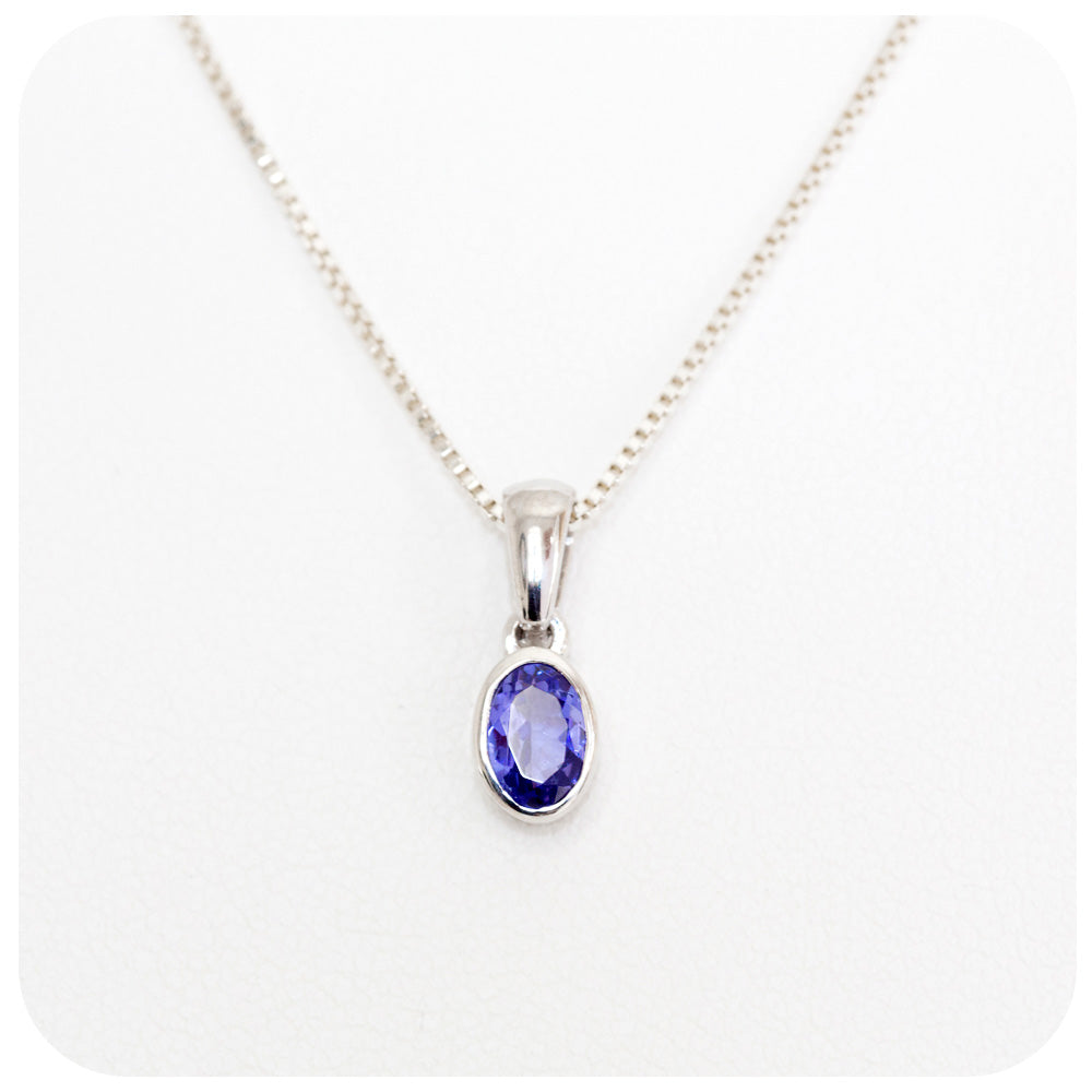 Oval cut Tanzanite Pendant Wrapped in a Sterling Silver Tube Setting - Victoria's Jewellery