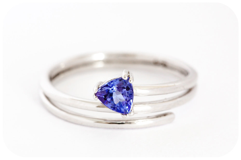 Trilliant Cut Tanzanite Warp-Around Ring Crafted in 925 Sterling Silver with a Fine Rhodium finish - Victoria's Jewellery