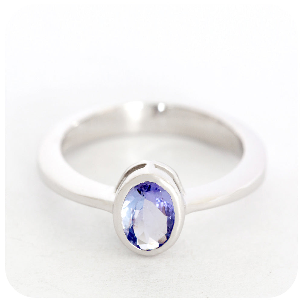 Dynamic 7x5mm Tanzanite Oval Cut Ring Crafted in 925 Sterling Silver - Victoria's Jewellery