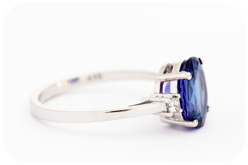 Oval cut Tanzanite and Diamond Ring in 14k White Gold