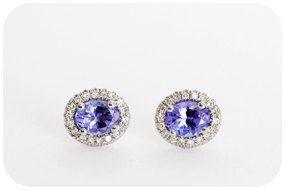 Oval cut Tanzanite and Diamond Stud Earrings in White Gold