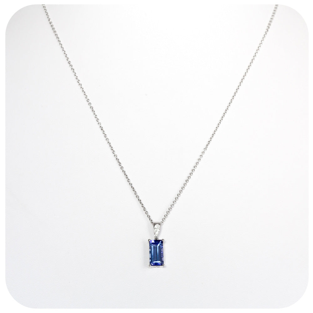 Striking Emerald cut Tanzanite and Diamond detail Pendant in White Gold - 2.29ct
