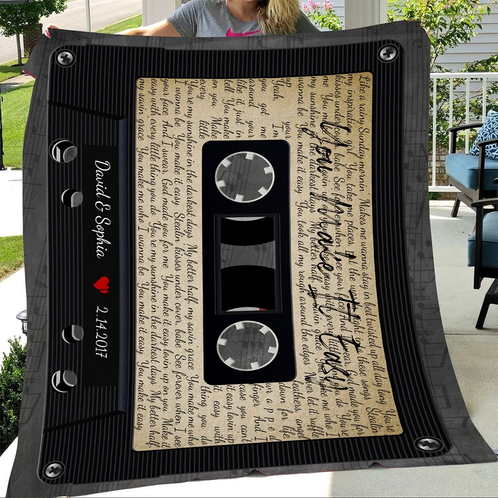 A custom song lyrics blanket with a design of the cassette tape may be what you're searching for. Accompanied with the lyrics surrounding the cassette frame, this classical-style blanket can play any song you want. You can add your names and your anniversary date with an extra personal touch.