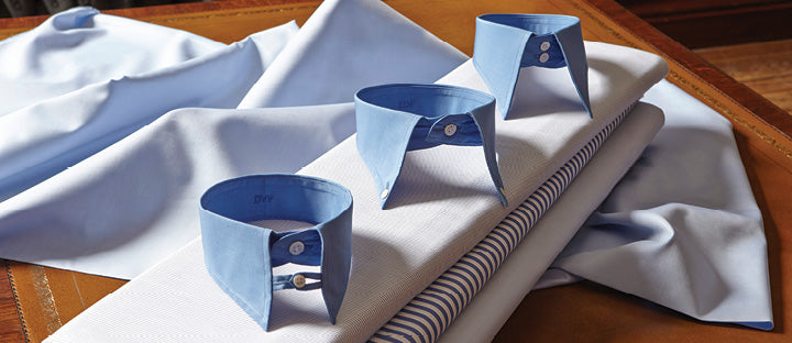 A selection of collars resting on fabric