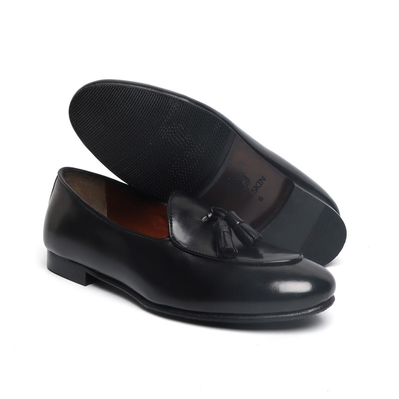 Black Leather New Sleek Look Tassel Slip-Ons by BARESKIN