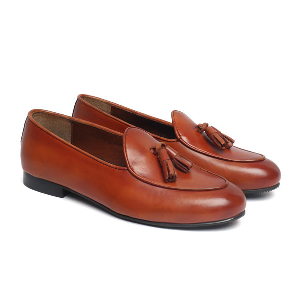 Tan Leather New Sleek Look Tassel Slip-Ons by BARESKIN