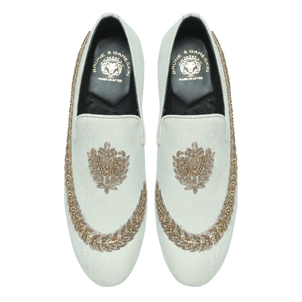 BARESKIN  IVORY HAND ZARDOZI SLIPON WITH STEM DESIGN .