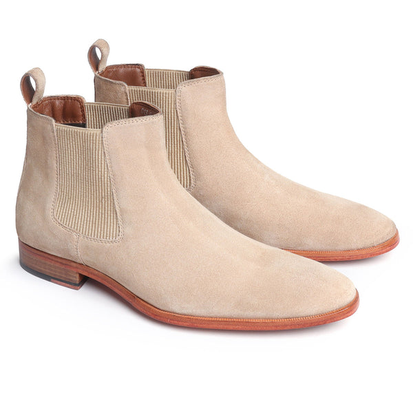 Beige Suede leather Chelsea boots with leather sole.