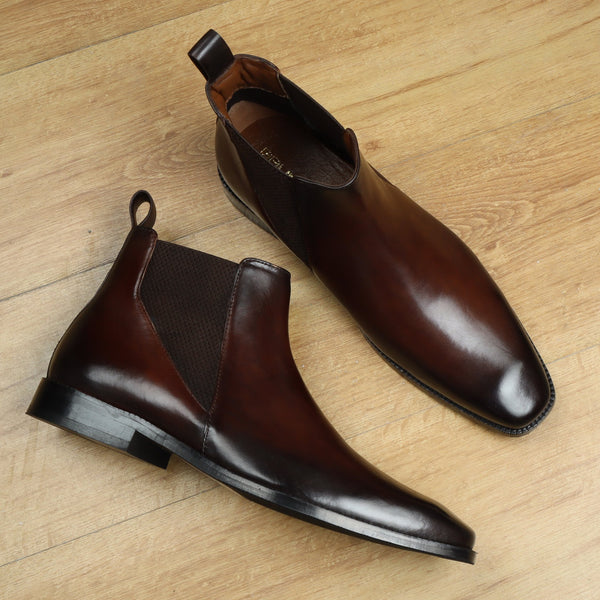 New shape Chelsea boot by Brune with a stylish sharp elastic design .