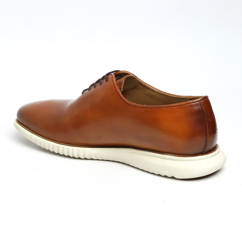 Tan One Piece Leather Sneakers By Bareskin