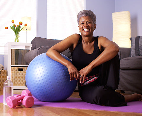 woman sits happy after exercising