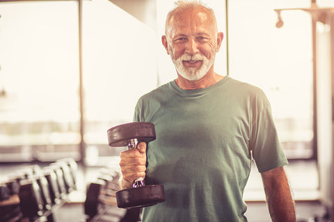 Healthy Senior Man Lifts Weights