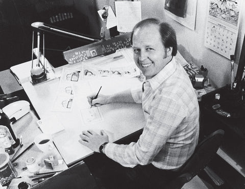 Jim Davis working at his drawing table in the late 70's.