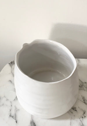 Slanted white pot