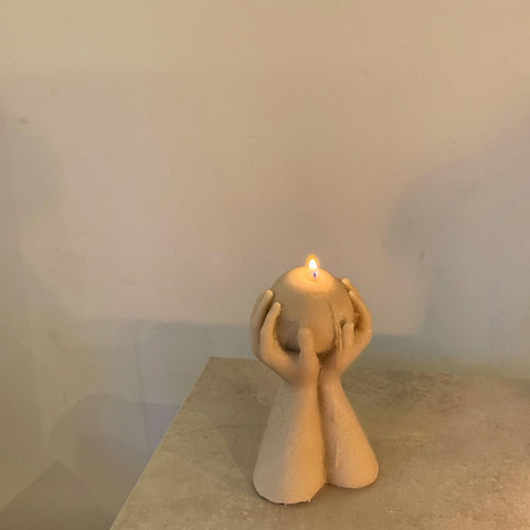 uplift hands candle