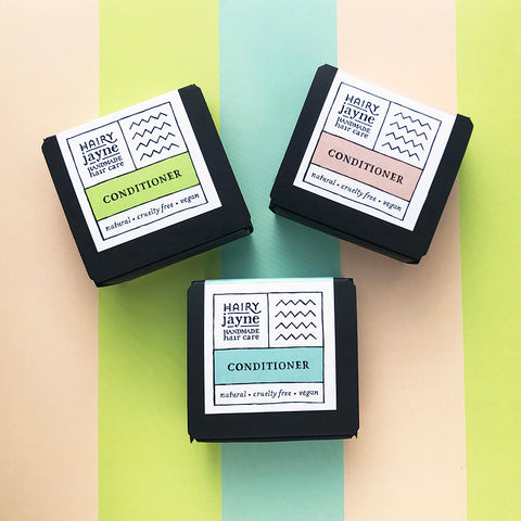 three conditioner bars in boxes with different fragrances, floral, citrus, musk