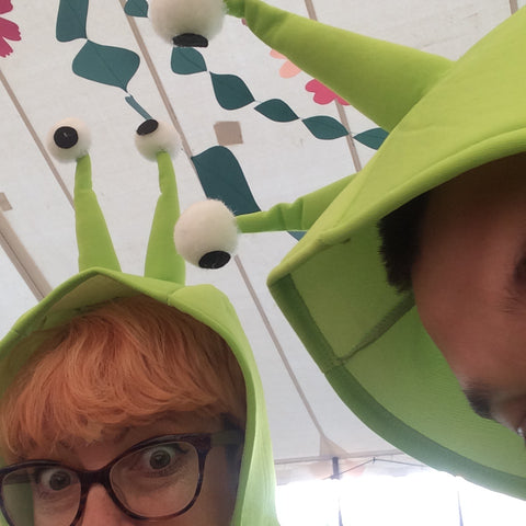 jayne and friend in snail costumes in a decorated festival tent