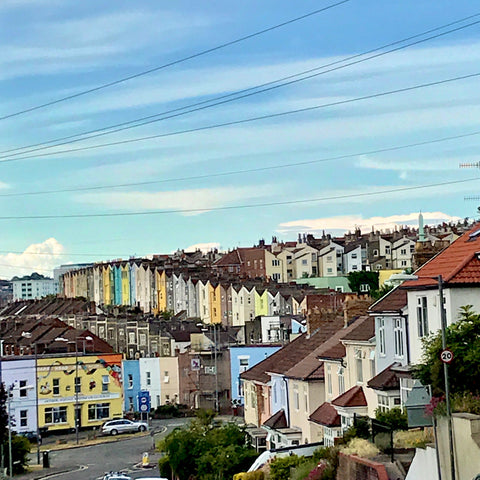 lovely view of totterdown in bristol with different coloured houses and blue sky