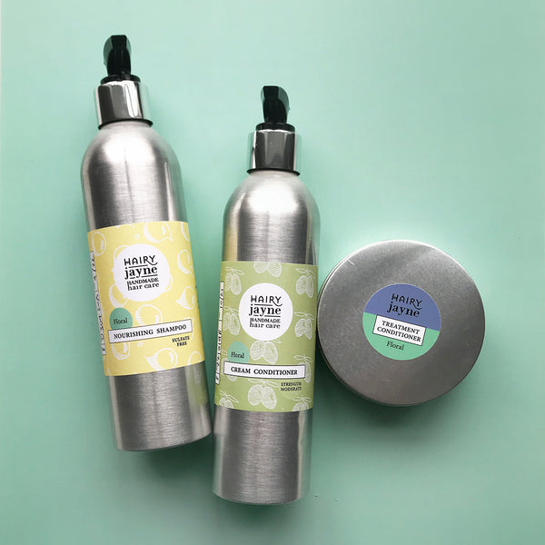 floral fragranced nourishing shampoo, cream conditioner, travel size treatment conditioner all in aluminium containers