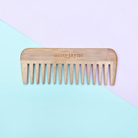 bamboo comb on mint and lilac background