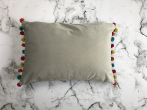Dove grey pom pom cushion