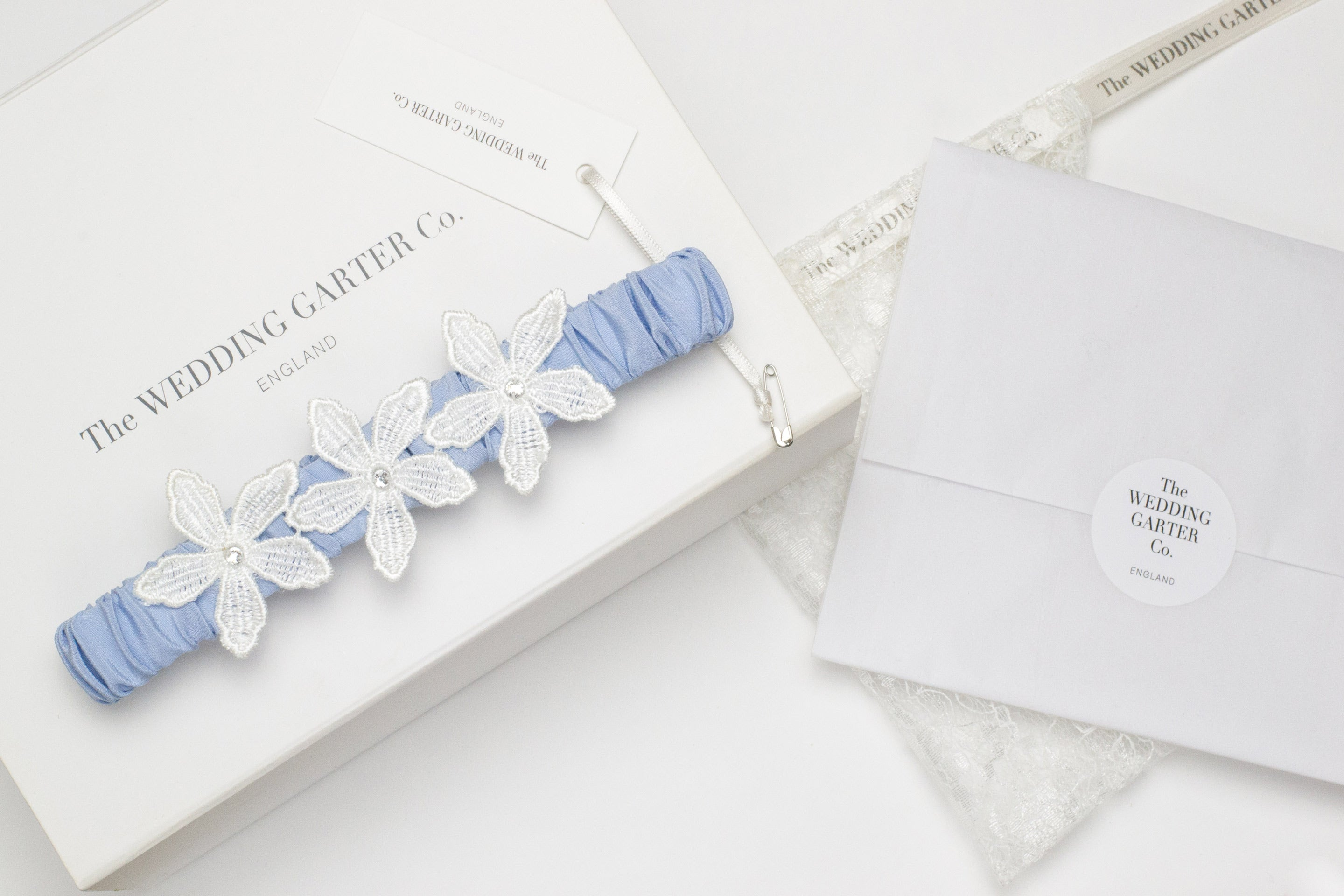 Blue bridal garter by The Wedding Garter Co.
